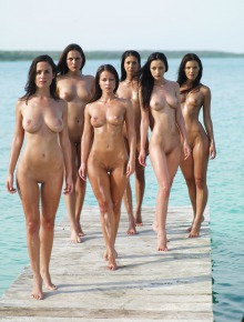 6 Sexy Girls are sunbathing on a pier