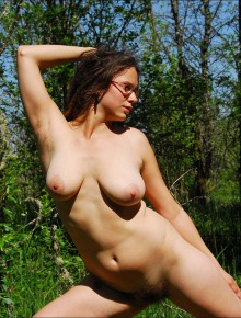 Amaya poses nude and shows off her large breasts and hairy body
