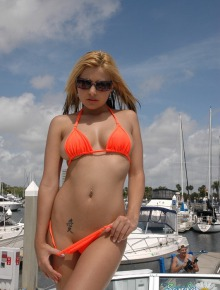 Babe posing in orange bikini