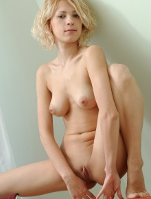 Beautiful blonde with shaved pussy