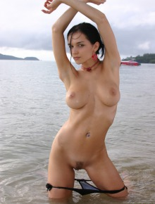 Big boobed babe on the beach