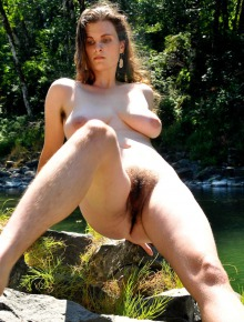 Brunette hippie with large breasts and hairy bush outdoors