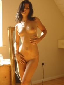 Brunette takes off her clothes