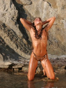 Erotic nude babe on the rocks