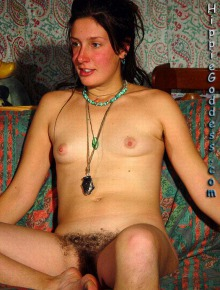 Hairy chick poses nude at home