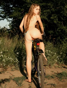 Hairy girl on the bicycle