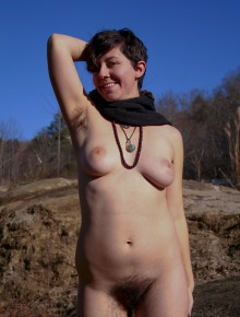 hippie girl with large breasts and hair all over