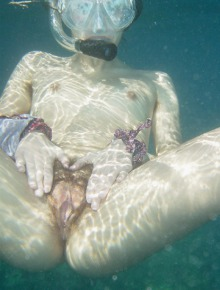 Naked babe under the sea