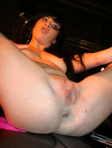 Party chick in pink taking off her clothes