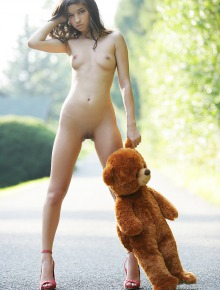 Pretty teen with toy