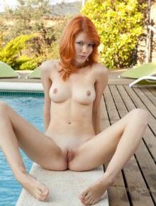 Redhead girl takes off her bikini