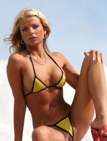 Sexy blonde with big breast in extreme micro-bikini