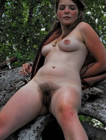 Sexy young hippie goddess outdoors with hot hairy body