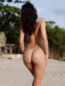 Shaved pussy brunette on the beach