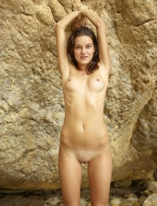Shaved pussy chick on the beach