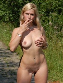 Smoking babe getting nude in nature