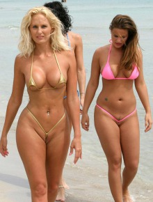 Three girls in micro bikini at the public beach
