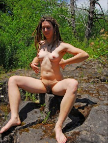 Very hairy dread locked hippie girl out in nature