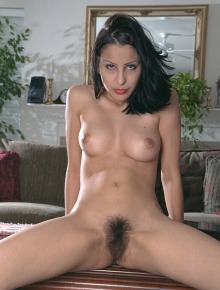 Hairy brunette takes off all her clothes